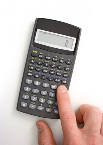Top view of using a pocket calculator