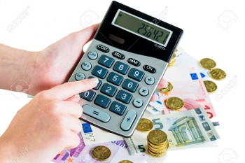 26163007-hand-with-calculator-and-bills-symbolic-photo-for-turnover-profit-taxes-and-costing-Stock-Photo
