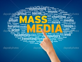 Finger pointing a an Mass Media Word Cloud on blue background.