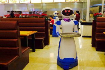 "Pic shows: This restaurant has robot as waiters. A Chinese restaurant owner inspired by the restaurant Bots from the hit US show Sam and Cat has created a restaurant filled with robots. The robot restaurant on the TV show features robot waiters like Tandy and Bungle, and now a restaurant in Ningpo, a seaport city in north-eastern China's Zhejiang province, has also taken on robot staff. Although wages for the robots in the city's Liancheng shopping mall are non-existent, they still do not come cheap at around 6,000 GBP each. But with a five-year-warranty on each robot, and the fact that they only need to be charged four-hours-a-day, the owner Lu Dike, 48, reckons in the long-term it is going to save a fortune on wage bills. And the robots have not just been popular with fans of the US series, but also with people who have not even seen the show and want to experience being serviced by robot staff. The ""waiters"" navigate their way around with the use of an optical sensing system, enabling them to independently serve food to any table within the restaurant. Additionally, the robots have the capability to speak up to 40 phrases in Mandarin Chinese, such as ""enjoy your meal"". And restaurant owner Dike is even being pressured now to put the robots on sale for people to take home. He said: ""I get asked at least once a day if I'm prepared to sell one of them, who knows, maybe it might be a good sideline."" One of those who wants to buy one was customer Xu Yuan, 34, who said: ""I really like the service and I think I would really like one at home, my son has been pestering me ever since we came here for a snack after a trip to the movies."" (ends)"