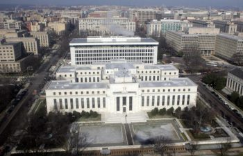 "The US Federal Reserve Building is seen from the air over Washington, DC, 18 January 2008. President George W. Bush called Friday for Congress to act quickly on a stimulus plan worth around 140 billion USD to revive a US economy that some fear is on the brink of recession. Bush said that he has consulted with lawmakers and added: ""I believe there is enough broad consensus that we can come up with a package that can be approved with bipartisan support."" The news came amid the latest round of weak economic news and a downward spiral on Wall Street that prompted Federal Reserve chairman Ben Bernanke and others to talk up the need for swift action. AFP PHOTO/SAUL LOEB (Photo credit should read SAUL LOEB/AFP/Getty Images)"
